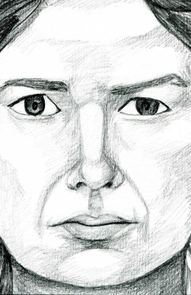 The image shows a piece of artwork by Jina Wallwork. It is a drawing of a person, a self portrait. Stylistically this piece of artwork has links with realism.