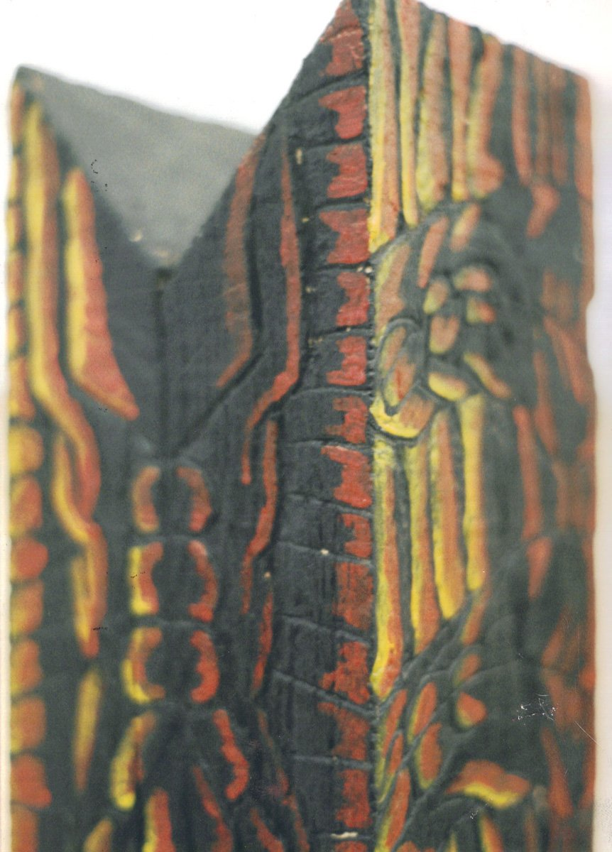 The image shows a piece of artwork by Jina Wallwork. It is a wood sculpture.
