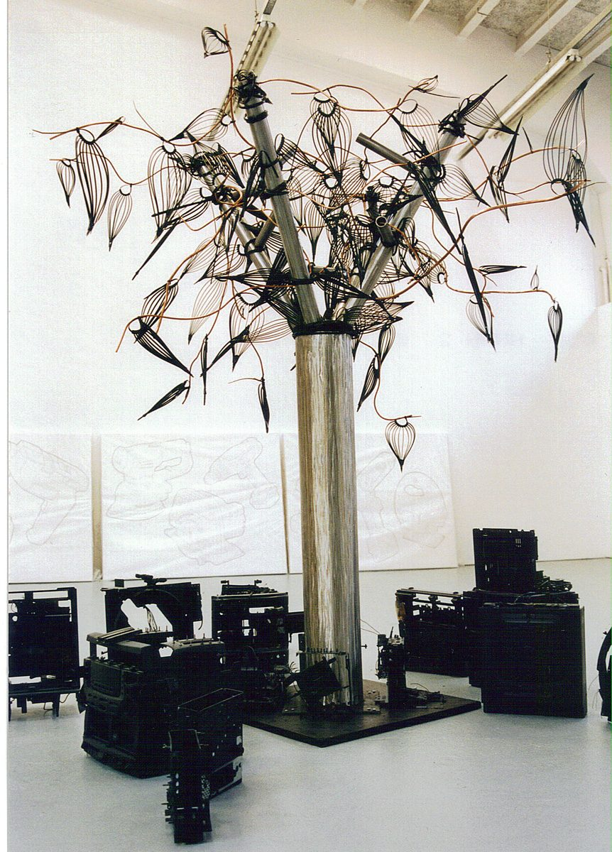 The image shows a piece of artwork by Jina Wallwork. It is a sculpture of a tree. There have been different versions of this sculpture. This is version 1.